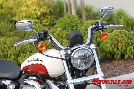The handlebar has slightly more rise, and the triple trees are wider, giving the SuperLow a more masculine appearance.